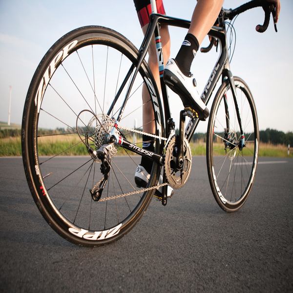 How is using polymer bearings in bicycles advantageous?